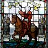 "John Wesley stained glass window, with caption ""the world is my parish"""