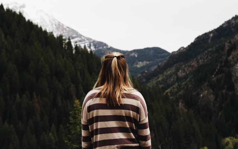 Girl looks out over mountains