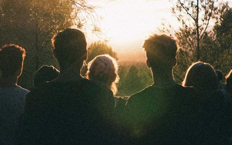 Group of people looking at sunrise